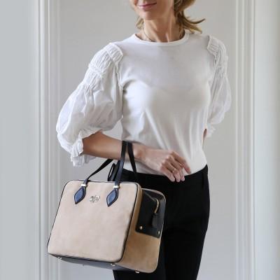 Handbag in nubuck and calf, beige color - on a model