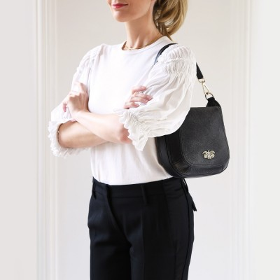 """Crossbody bag """"NEW FRENCHY"""" in grained leather, black color, on shoulder"""