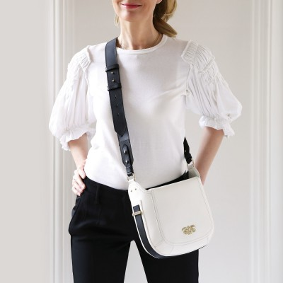 Crossbody bag NEW FRENCHY in smooth leather, white color - worn by a model in paris
