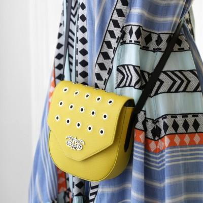 Small shoulder bag DINA ROCK in grained leather, lemon color - close-up on model