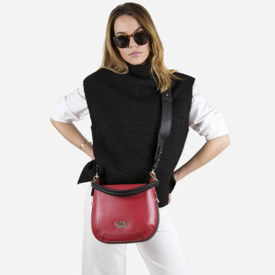 Crossbody bag NEW FRENCHY in smooth leather, red color - on a parisian model