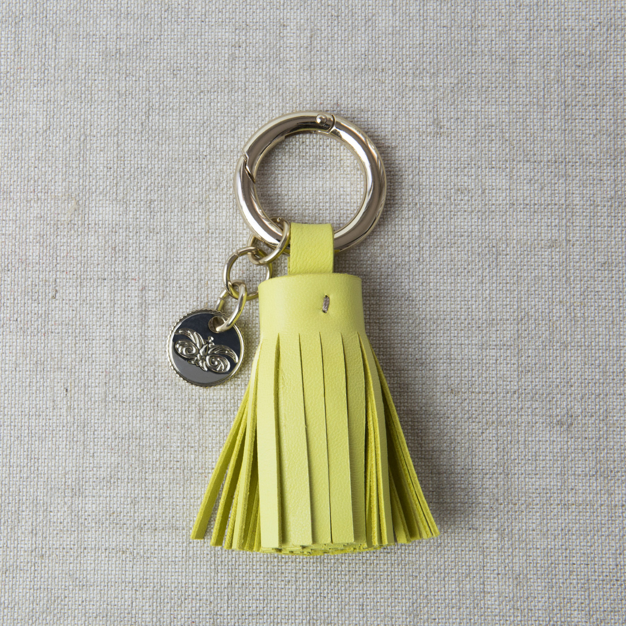 Key holder and bag charms TASSEL in lambskin, anis color and gold - on linen