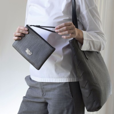 Lambskin zipper pouch with wrist strap, kaki color - on model
