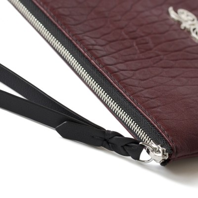 Flat zipper pouch with wrist strap in soft leather, burgundy color - wrist strap details