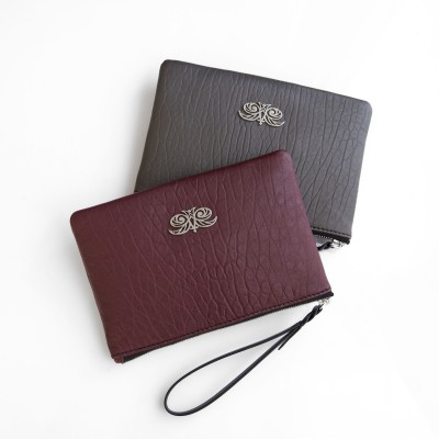 Lambskin zipper pouch with wrist strap, burgundy and kaki colors - front view